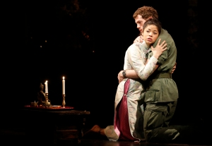 "Actors Alistair Brammer and Eva Noblezada perform as Chris and Kim during a photocall for a new production of ""Miss Saigon"" at the Prince Edward Theatre in London May 19, 2014. The production marks the 25th anniversary of the musical by Claude-Michel Schonberg and Alain Boubil. REUTERS/Luke MacGregor (BRITAIN - Tags: ENTERTAINMENT)"